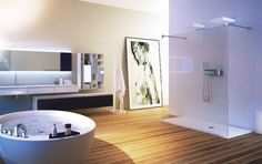 luxury bathroom with freestanding tub and glass shower