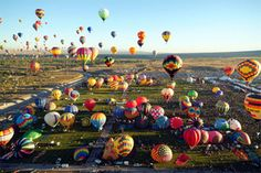 I would love to see so many balloons in the sky at once.  I am excited when I see just one.  It is hard to imagine seeing 100's!  I would love to go up in one...maybe a tethered one!