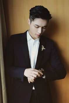 Zhang Yixing (EXO's Lay) looking mighty fine in Saint Laurent Le Smoking tuxedo with Abeille lapel pin & watch by Chaumet for Bazaar Star Charity event.