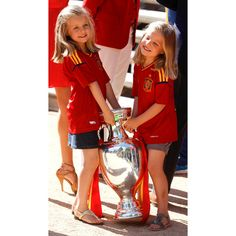 The sisters showed off their team spirit in La Furia Roja jerseys as they welcomed Spain's soccer team to Zarzuela Palace after winning the 2012 UEFA European Championship.