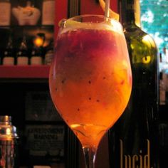 Brazilian Sangria - Cachaca Cocktail Fresh seasonal fruit (recommended: strawberry, lime, orange, kiwi and passion fruit) .25 oz Lucid Absinthe 1.25 oz Cachaça .5 oz Spanish brandy .5 oz Orange liqueur 1 oz Red wine