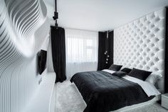 Geometrix Design have completed a black and white bedroom featuring a wavy wall.