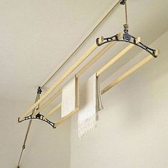 drying rack that drawstring lifts to the ceiling...comtemporary looking yet clever because it it makes more space!