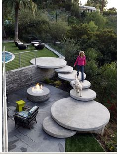 Round concrete steps bridging levels in the back yard - Lara Spencer and David Haffenreffer home, Beverly Hills, CA