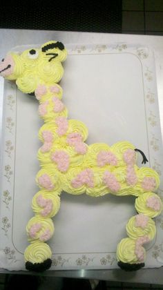 Giraffe Cupcake Cake Pull apart cupcake cake...buttercream with black fondant detail.