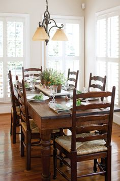 A rustic wooden table paired with traditional ladder-back chairs looks classic and fresh. Dining Room Table, Ladder Back Dining Chairs, Kitchen Dining, Kitchen Decor, Kitchen Ideas, Rustic Wooden Table, Wooden Dining Tables, Wood Table, Cottage Kitchens