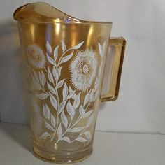 Iridescent Depression Glass Pitcher with glasses...love these!