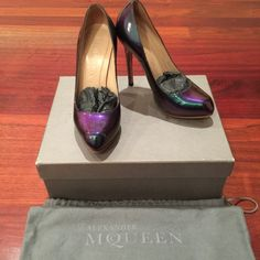 100% authentic Alexander McQueen pumps Price FIRM! 100% authentic Alexander McQueen patented multi color petrol verni pumps. These are absolutely stunning! Patent leather reflects in different colors under the shade or under the sun, from dark green to blue to purple!!! 4.5 inches in the back and 0.5 inch platform. No trade please! Price is FIRM! Alexander McQueen Shoes Platforms
