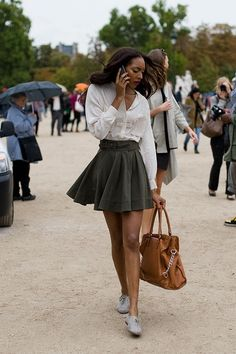 Paris Fashion Week SS 2011....After Christian Dior - Love the short flared skirt with laced up oxfords.