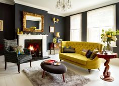Black Wall Interior with mustard yellow sofa for high contrast - love how the modern elements were paired with trafitional elements