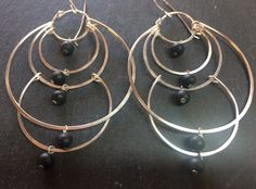 A personal favorite from my Etsy shop https://www.etsy.com/listing/234946685/matte-black-onyx-multi-hoop-chandelier