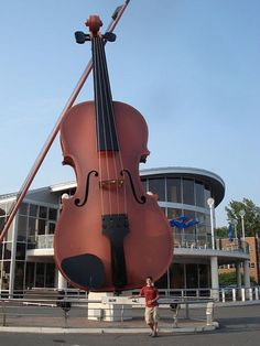 Worlds Largest Fiddle ~Sydney, NS It was part of a  plan to revitalize Sydney since local industries such as mining and steel dont provide jobs like they used to. The fiddle, and increased cruiseship traffic, draw thousands of tourists every season to the biggest city in Cape Breton. Its meant to celebrate the regions Celtic folk music heritage.(Photo: Spiritrock4u, Wikimedia)