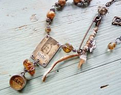 I love this piece.  her work on the chain (?) is really interesting.  check out the blog/board........Nina Bagley