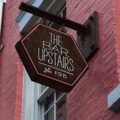 This #vintage looking bar sign is simple and tasteful, yet it stands out well amongst other signs because of its hexagonal shape. The cast iron really gives it the vintage/industrial look. Also, the font is easy to read and well proportioned, so it can attract foot traffic.