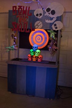 Bowl the Skull Great idea & I love the neon skulls... just set up the game so you have a bit of lane to bowl on.