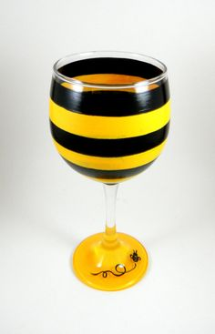 Bee wine glass by ImpulsiveCreativity on Etsy, $20.00                                                        Wonder what group needs these little bees???