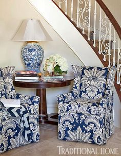 A pair of chairs covered in blue-and-white damask fabric welcome at the foot of the stairs. - Traditional Home ® / Photo: Nancy Nolan / Design: Tobi Fairley Decor, Blue Decor, Interior, Blue Rooms, White Decor, Home Decor, House Interior, White Rooms, Blue White Decor