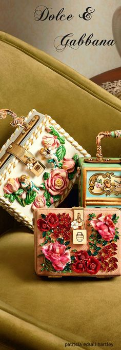 Absolutely love this peach white and teal Metallic box clutches with 3D floral designs and a intertwined floral handle with mini gold padlock on the front   Wedding accessories   Indian clutch bag purses    Credits: Dolce & Gabbana   Every Indian bride's Fav. Wedding E-magazine to read. Here for any marriage advice you need  www.wittyvows.comshares things no one tells brides, covers real weddings, ideas, inspirations, design trends and the right vendors, candid photographers etc.