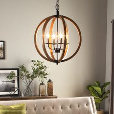 Rustic enough to please a Norse god while remaining perfect for the modernist with it's clean, open design, this chandelier's distressed wooden sphere is…