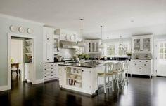 White kitchen, dark benchtops, dark floors.