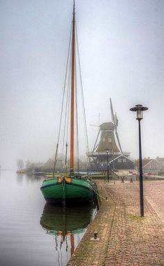 Boat and Windmill on a Misty Day, Friesland, Netherlands ~ Photography by Holland Windmills, Misty Day, Amsterdam Holland, Visit Amsterdam, Le Moulin, Tall Ships, Sailing Ships, Kayaking, Places To See