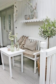 Tour of charming country cottage in Norway full of sweet vintage touches; love this scalloped shelf on the clean and cozy porch — Eclectically Vintage