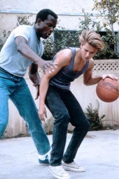 Wayyyyy too high there with the ball, River. // Sidney Poitier, River Phoenix (LIFE)