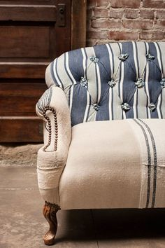 We love the mix of patterns in this vintage linen sofa via The Found Blog. #homedecor #inspiration