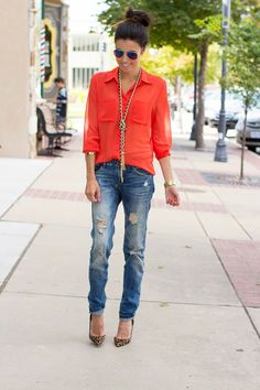 Bright coral top, distressed jeans, leopard heels, long statement necklace...