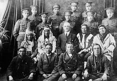 Recruits from the Saskatchewan's File Hills community pose with elders, family members and representative from the Department of Indian Affairs before departing for Great Britain. National Archives of Canada/PA-66815