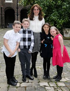 Catherine, Duchess of Cambridge poses with Solei Neil-Brown, Kiera Mullins, Haydan Pearce and Joshua Hogan, children from the 'Real Truth' video blog that features on the Huffington Post website at Kensington Palace on February 17, 2016 in London