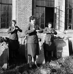 Lee Miller's stunning images of women in wartime: ATS officers getting changed in Camberley, Surrey, 1944. After performing their drills in a muddy field, these trainee ATS (Auxiliary Territorial Service) officers rapidly change into uniform for their next assignment. This photograph reveals an intimacy with its subjects that only a woman could have achieved: had a man been behind the camera, the women would all have rushed to hide ~