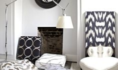 Prestigious Textiles -  Atmosphere Fabric Collection - Black, white and silver fabrics in a minimalist room