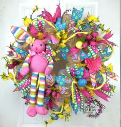 Deco Mesh Easter Bunny Wreath -Pink -Yellow -Spring Door -Turquoise by www.southerncharmwreaths.com #easter #decomesh #wreath