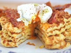 Don't be fooled! Those waffles are made of mashed potatoes & topped with plenty of bacon, eggs & cheese.