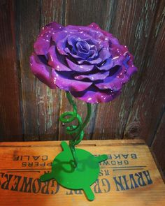 This is one of my Blacksmith Roses that I was asked to paint.  Hand crafted at Thymelyglass Studio