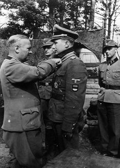 The commander of the III. (Germ.) Panzerkorps, SS-Obergruppenführer und General der Waffen-SS Felix Steiner presents the Knight's Cross, the highest award made by Germany to recognize extreme battlefield bravery or outstanding military leadership, to Estonian SS-Obersturmbannführer Harald Riipalu, born 13 February 1912 in St. Petersburg. Knight's Cross awarded on 23 August 1944.