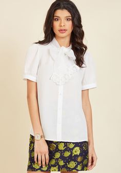<p>Of course this white blouse is excellent for the office, but did you know it also wows at networking fetes and seminar speeches? While the puffed shoulders and short sleeves of this button-up top offer professional polish, its sheer fabric and lace-trimmed neckline tie speak to the career-driven fashionista!</p>