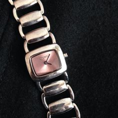 DKNY pink faced bracelet style watch. Xtra link. Silver DKNY watch with shimmering pink face. Like new condition, present from hubby but I don't wear watches. Needs battery. Includes extra link. Bracelet style. Very feminine and cute.  DKNY Accessories Watches
