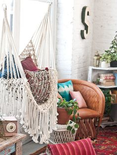 Decorate with macrame wall hangings and hammocks.