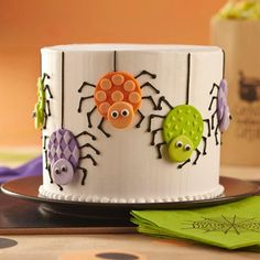 Spider Cake - Easily make colorful fondant spiders using Wilton White Decorator Preferred Fondant and Round Double Cut-Outs Set. The creepy-crawlies decorate the side of a cake that's perfect to serve at a Halloween party.