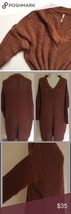 Free people oversized knit sweater In great used condition, slight pilling on sleeves. Color burnt orange/brown. Tunic length. Medium size but fits oversized, more like a large or XL. FIRM ON PRICE NO TRADES Free People Tops Tunics