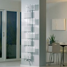 The trendy Parallel Rail White Vertical Towel Radiator features a tall, white structure with a parallel design. This piece would look elegant in any modern bathroom.