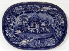 """STAFFORDSHIRE BLUE TRANSFER PLATTER, EARLY 19TH C., L 11 3/4"""":An oval platter with notched corners transfer printed in blue with two hunters and two hounds at the well, country house in the background, within a bold floral border with two game birds."""