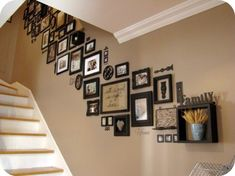 awesome frame collage going up the wall of a stairwell.