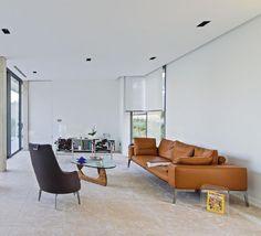 Flexform's Lifesteel sofa and Guscioalto armchair adorn this modern interior.