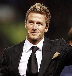 David Beckham in a fab black suit. -- Grace Ormonde Wedding Style