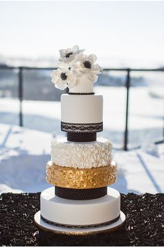 obsessed with this cake via StyleUnveiled.com / Sofia Katherine / Winter Wedding / Striped Wedding Details