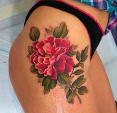 Pink flower thigh tattoo
