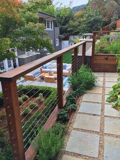 A Family-Owned Business Maximizes the Versatility of Cable Railing – Design*Sponge Deck Railing Planters, Wood Deck Railing, Cable Railing, Railing Design, Patio Design, Porch Railings, Railing Ideas, Fence Design, Garden Design